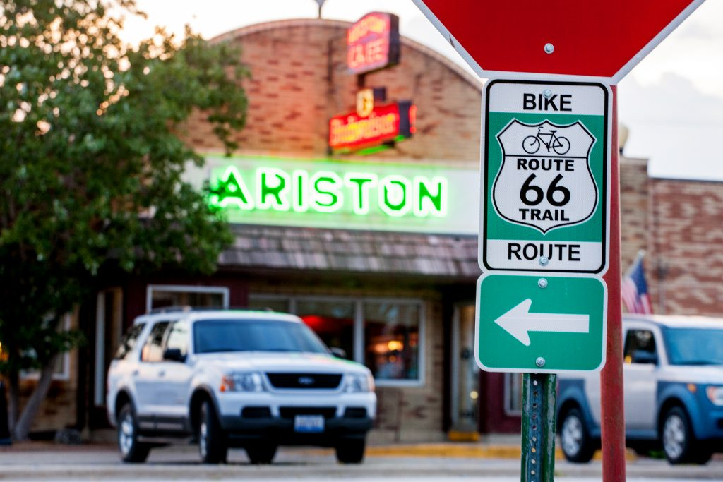 Route 66 Bicycle Trail sign in front of the Ariston Cafe