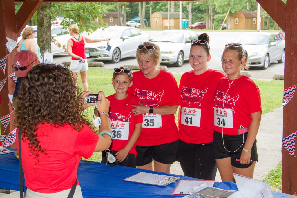 A family registering for the 5K Freedom Fun Run