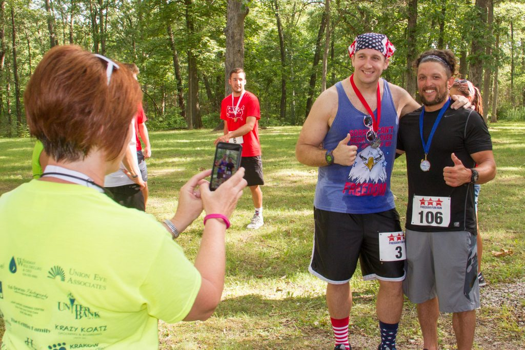 Runners taking a photograph.