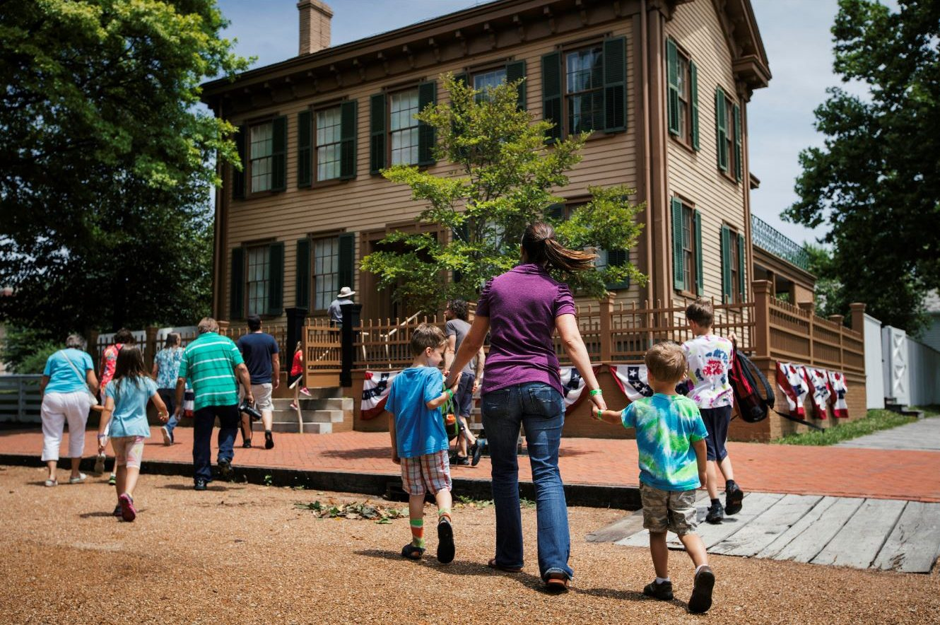 People in front of Lincoln Home Historic Site, walking towards building. Photo Credit: Adam Alexander