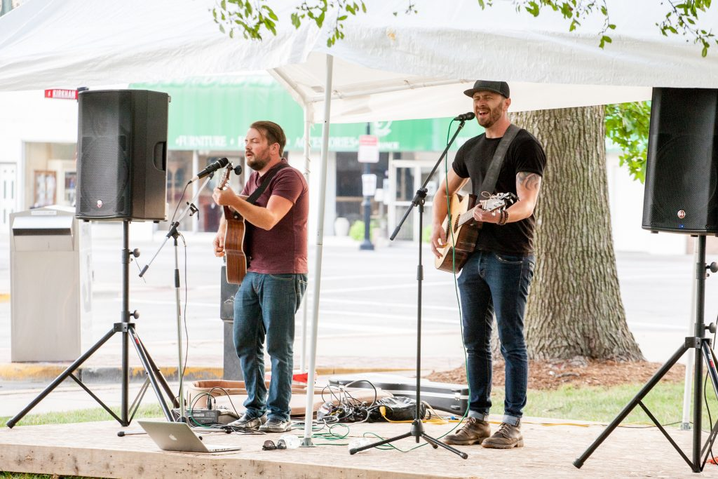 Two musicians perform at Live in Library Park