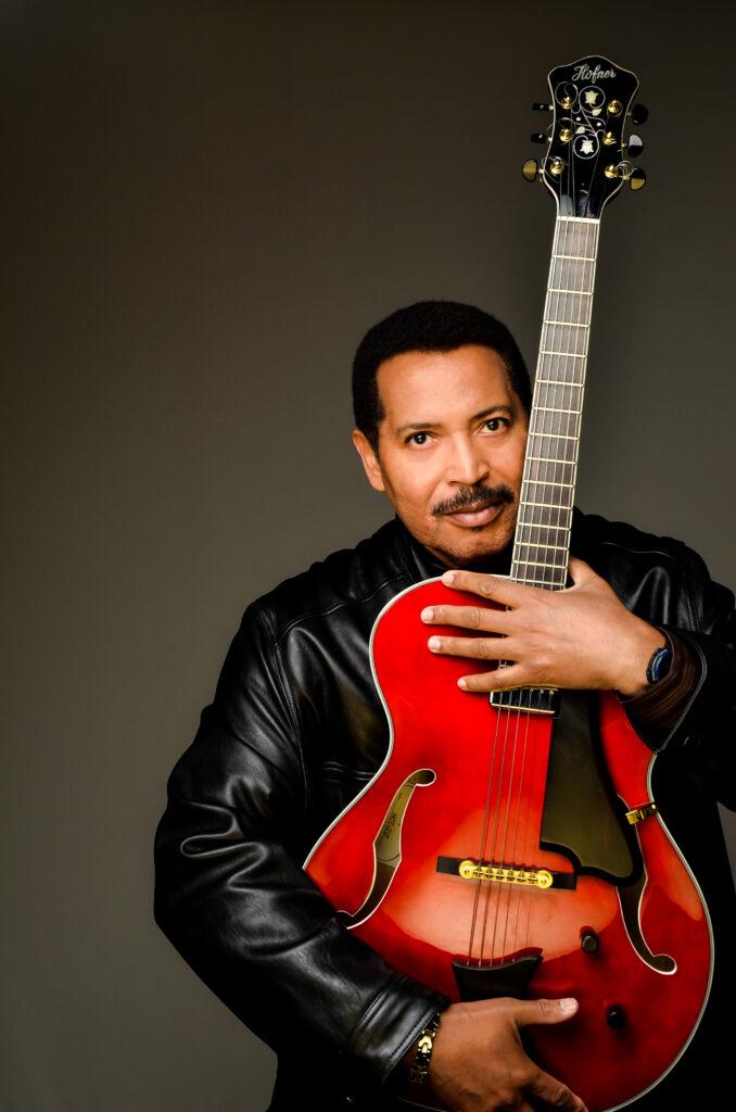 Vince Martin holding Guitar